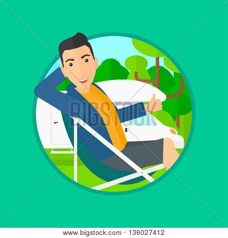 Young man sitting in a folding chair and giving thumb up on the background of camper van. Man enjoying vacation in camper van. Vector flat design illustration in the circle isolated on background.