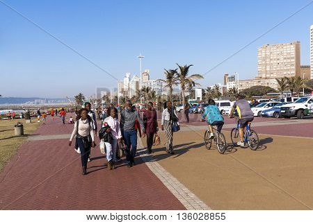 People And Cyclists On  Promenade On Beach Front