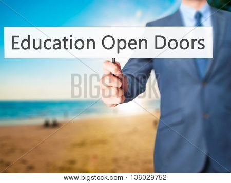 Education Open Doors - Businessman Hand Holding Sign