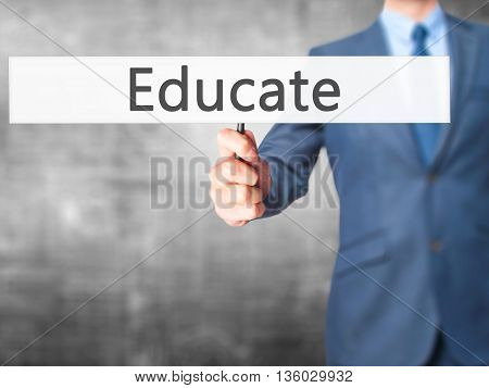 Educate - Businessman Hand Holding Sign