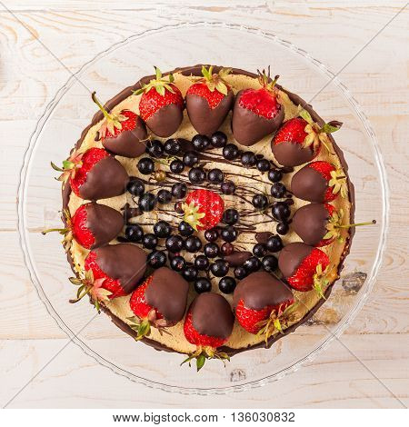 Delicious cheesecake with berries on table close up. White wooden background. Tasty dietary pastries. Natural product. Light dessert. Top view. From above.