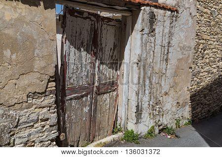 old broken wooden door in abandoned stone house. Lefkara. Cyprus