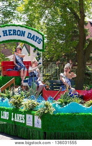 WEST ST. PAUL, MINNESOTA - MAY 21, 2016: Ambassadors to Lino Lakes Heron Days Festival wave to crowd at annual West Saint Paul Days Grande Parade on May 21.