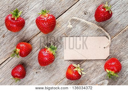 Red strawberries and blank tag tied with string