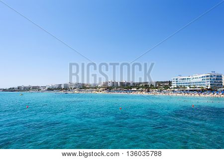 PROTARAS CYPRUS - JUNE 12 2016:Photo of sea and fig tree bay beach in protaras cyprus island with swimming people and hotels.