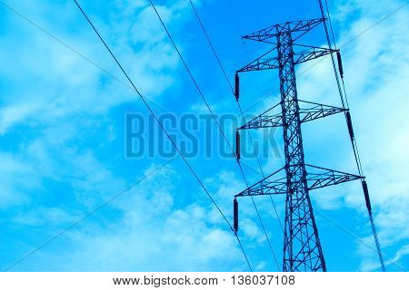 Electrical high voltage pole and blue cloudy sky (Fluorescent Filters)