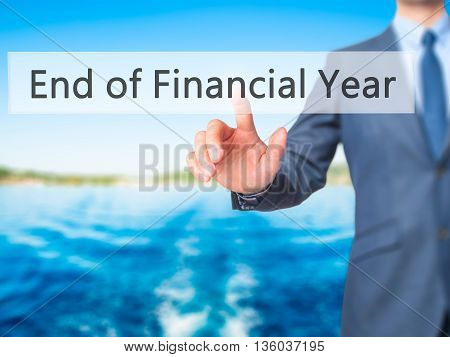 End Of Financial Year - Businessman Hand Pressing Button On Touch Screen Interface.