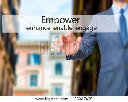 Empower Enhance, Enable, Engage - Businessman Hand Pressing Button On Touch Screen Interface.