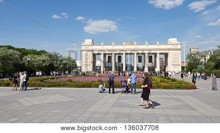 Moscow - May 9 2016: A lot of people walk in Gorky Park near the main entrance to the park and beautiful flower beds with tulips May 9 2016 Moscow Russia