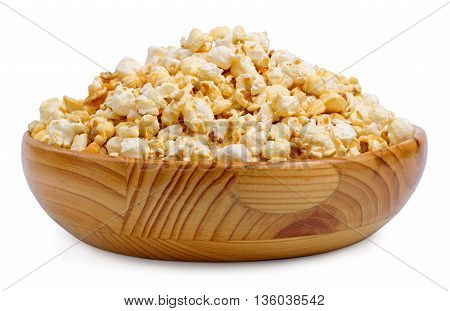 Popcorn in a wooden bowl isolated on a white background