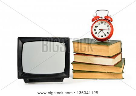 Vintage analog portable TV, some old books and retro alarm clock  isolated on white