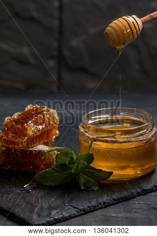 Honey Dripping From A Wooden  Dipper