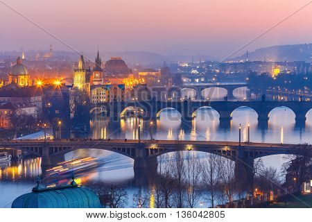 Aerial view of Old Town and bridges over Vltava River at night in Prague, Czech Republic