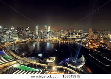 Singapore Marina Bay rooftop view with urban skyscrapers at night.