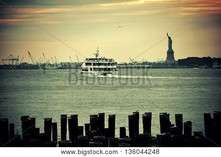 Statue of Liberty at New York City harbor with pier.