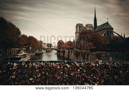 Paris River Seine with Notre-Dame cathedral and padlock in France.