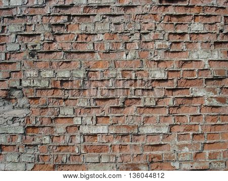 Ordinary red brickwork masonry old wall .