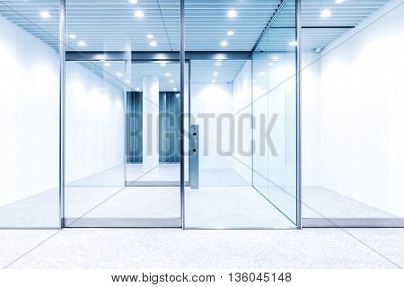 glass door with hi-tech fingerprint lock in modern building