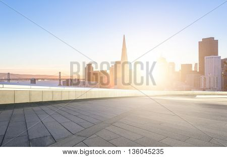 cityscape and skyline of san francisco at sunrise on view from empty floor