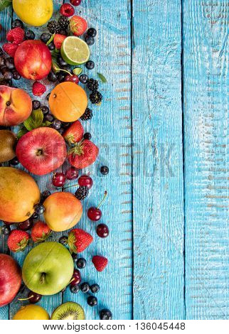 Close-up of fresh fruit mix placed on old wooden planks