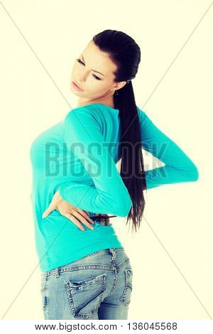 Young woman with backache