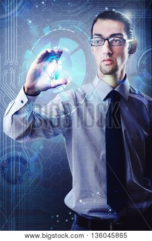 Businessman pressing virtual button in futuristic concept