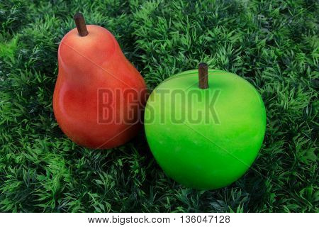 Two Fruits , Pear And Green Appleunder Green Grass For Children
