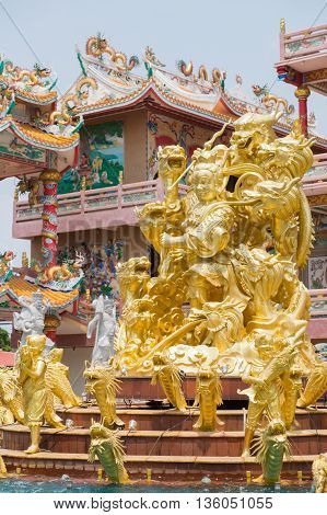 Golden statue of Naja god in Najasataisue Chinese Shrine (Thepsathit Phra Kiti Chalerm Chinese Shrine) located at Angsila Chonburi Thailand.