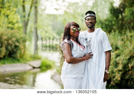 Rich African Couple At White National Dress And Sunglasses