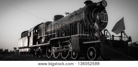 Black and white old steam locomotive in Thailand.