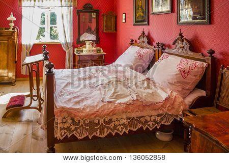 WDZYDZE KISZEWSKIE, POLAND - AUGUST 14: Bedroom furnishings in the old polish house on August 14, 2011 in Wdzydze Kiszewskie.
