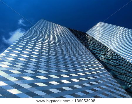 Modern skyscraper in business district with blue sky
