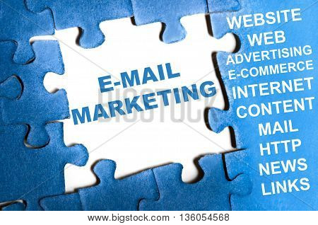 Email marketing blue puzzle pieces concept with tools