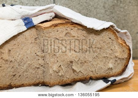 Crusty French Pain De Campagne Wrapped With A White Napkin
