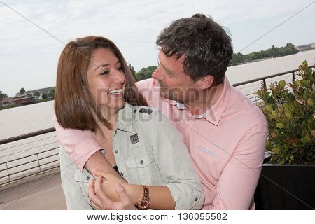 Loving Couple Sitting Over River, Lifestyle, Concept, Love, Tenderness