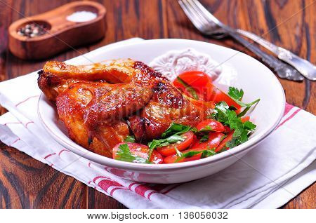 Grilled chicken and salad from cherry tomatoes and parsley