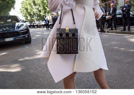 MILAN ITALY - JUNE 21: Detail of bag outside Armani fashion show building during Milan Men's Fashion Week on JUNE 21 2016 in Milan.