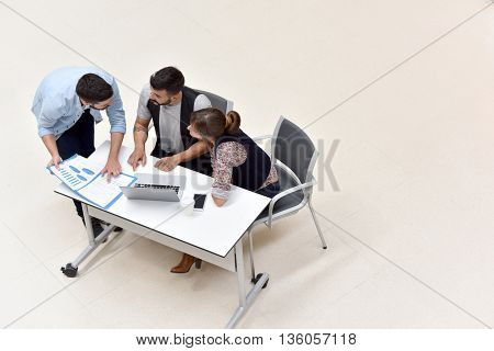 Upper view of business people meeting around table