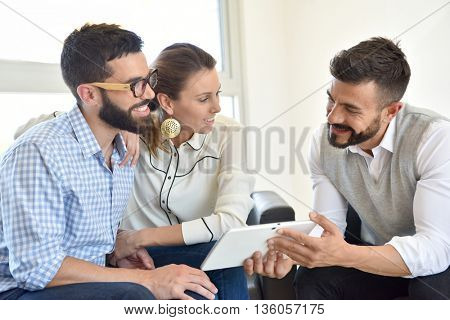 Couple meeting financial expert for business investment