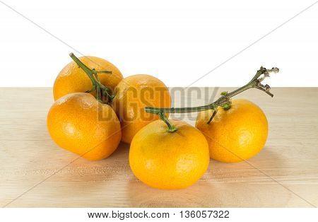 Group of orange on wooden base and isolated on white background. fresh orange isolated.