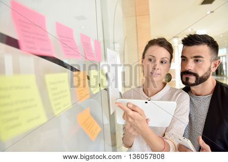 Young business people using tablet in office