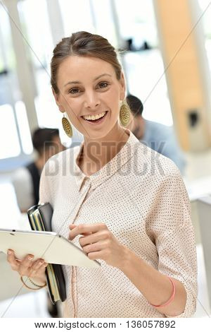 Businesswoman in meeting room using tablet