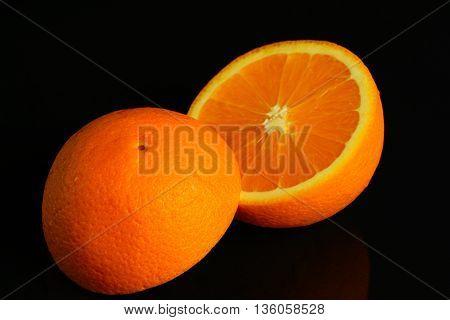 Orange Split half on dark background with copy space