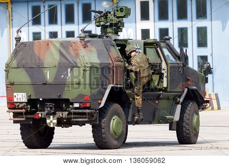BURG / GERMANY - JUNE 25 2016: german armored military infantry mobility vehicle ATF Dingo drives on open day in barrack burg / germany at june 25 2016