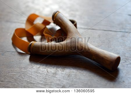 Traditional hand made wooden catapult on wood
