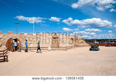 LAPPEENRANTA, FINLAND - JUNE 15, 2016: People go out from The Knight Sandcastle near Saimaa Lake