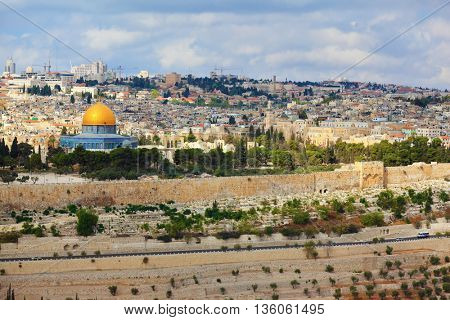 The ancient Jewish cemetery on Mount of Olives on background of old quarters Jerusalem. Seen  Golden Dome Mosque Dome of the Rock