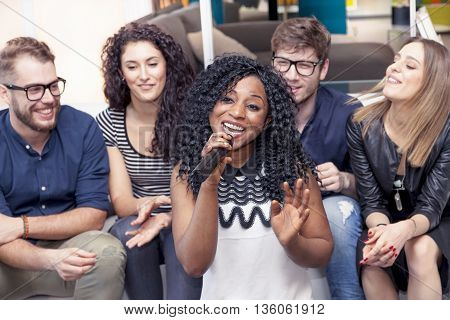 Group Of Friends Having Fun At Home Singing A Song Together