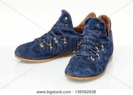 blue suede shoes isolated on white background