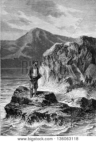 Man standing on a rock on the sea coast. From Jules Verne Dick Sand, a 15-Year Old Captain Book, vintage engraving, 1878.